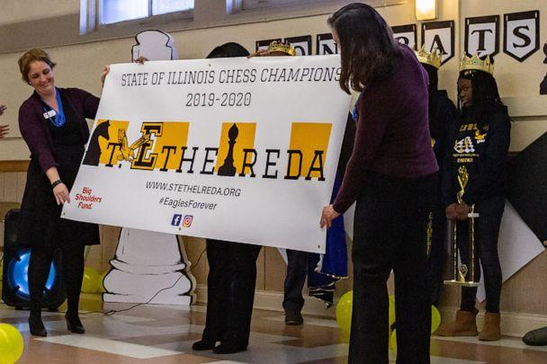 PHOTO: St. Ethelreda School is presented with a banner as state champions in chess during their pep rally. (Denise Duriga)