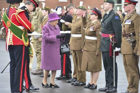 Britain's Queen Elizabeth presents leeks to soldiers from The Royal Welsh Regiment, at Lucknow Barracks during a visit to mark St David's Day, in Tidworth