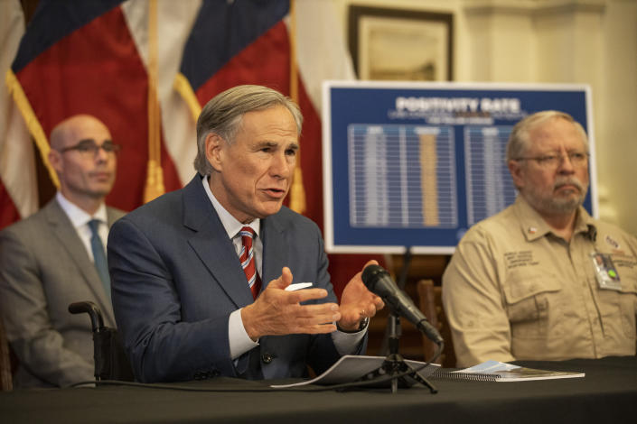 Texas Gov. Greg Abbott announces the reopening of more Texas businesses during the COVID-19 pandemic at a press conference at the Texas State Capitol in Austin on Monday, May 18, 2020.(Lynda M. Gonzalez/The Dallas Morning News via AP, Pool)