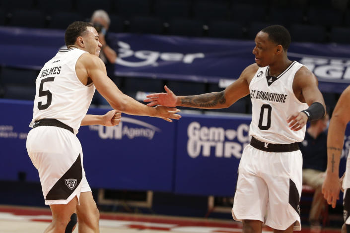 St. Bonaventure's Jaren Holmes, left, and Kyle Lofton celebrate after beating VCU in an NCAA college basketball championship game for the Atlantic Ten Conference tournament Sunday, March 14, 2021, in Dayton, Ohio. St. (AP Photo/Jay LaPrete)