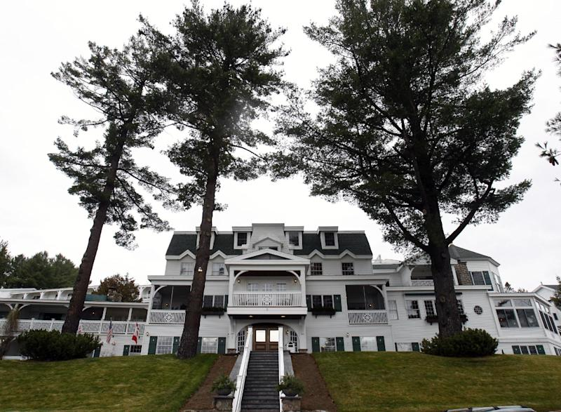 FILE - This file photo taken Nov. 13, 2009, shows the Mirror Lake Inn, in Lake Placid, N.Y. Welcome to the Mirror Lake Inn Resort and Spa, where hospitality is personal — but it's not just about the guests. Many of the inn's 165 employees stay for years. (AP Photo/Mike Groll, File)