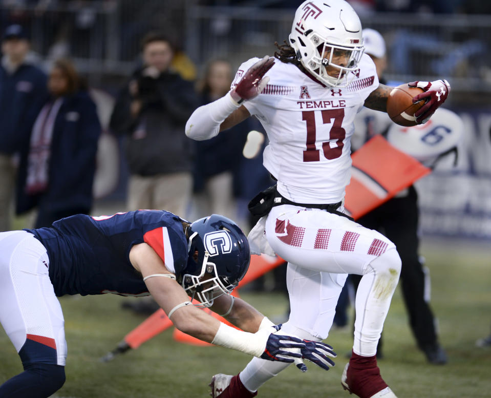 Temple wide receiver Isaiah Wright (13) scores the first of many TDs his team had in a 57-7 win over UConn. (AP Photo/Stephen Dunn)