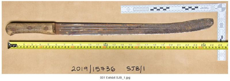 The 2ft long rusty machete. (PA Images)