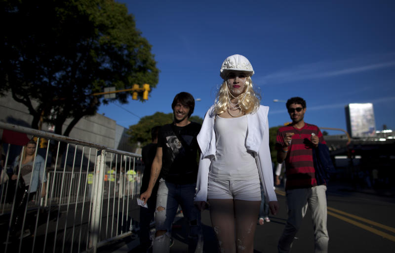 "Lady Gaga fans gather outside the stadium where the U.S. pop star will perform a concert, in Buenos Aires, Argentina, Friday, Nov. 16, 2012. The Latin American leg of her, ""Born This Way Ball Tour,"" is coming to an end but not before stopping in Chile, Peru and Paraguay,. (AP Photo/Natacha Pisarenko)"