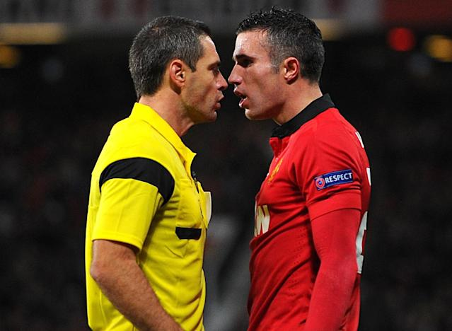 Referee Damir Skomina, left, speaks to Manchester United's Robin van Persie, prior to issuing him with a yellow card, during the Champions League Group A match against Bayern Leverkusen, at Old Trafford, Manchester, England, Tuesday Sept. 17, 2013. (AP Photo/Martin Rickett/PA )