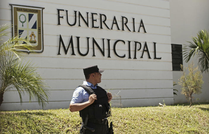 A municipal police officer stands outside the Municipal Funeral Home at La Bermeja Cemetery, where the bodies of Óscar Alberto Martínez Ramírez, 25, and his daughter Valeria, 23 months, arrived in San Salvador, El Salvador, Sunday, June 30, 2019. Martínez and his daughter were swept away by the border river between Matamoros, Mexico, and Brownsville, Texas, on Sunday, June 23, and their bodies were found the next morning. The wife and mother, Tania Vanessa Ávalos, survived. (AP Photo/Salvador Melendez)