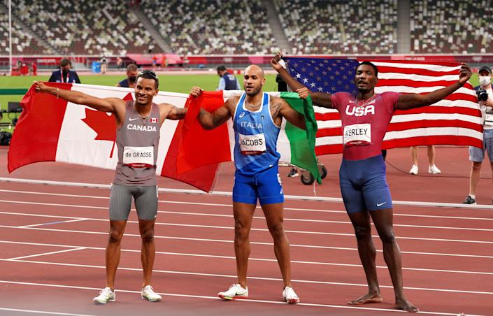 Jacobs, Kerley and De Grasse celebrate after the 100m in Tokyo. (Martin Rickett/PA) (PA Wire)