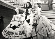 """This undated image from the film """"Gone with the Wind"""" provided by New Line Cinema shows, from left, Ann Rutherford, Vivien Leigh and Evelyn Keyes. Rutherford, who played Scarlett O'Hara's sister Carreen in the 1939 movie classic """"Gone With the Wind,"""" died at her home in Beverly Hills, Calif. on Monday, June 11, 2012. She was 94. (AP Photo/New Line Cinema)"""