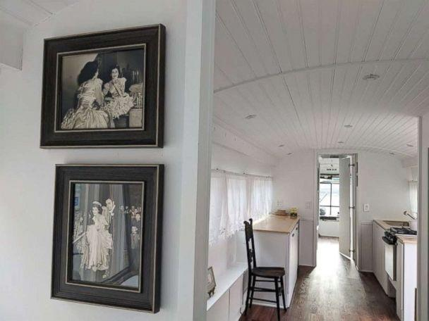 PHOTO: Jessie Lipskin hung old photos inside the RV she converted from a Greyhound commuter bus. (Courtesy Jessie Lipskin/@Thebustinyhome)
