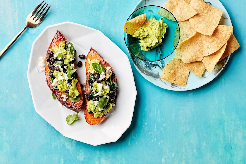 """When all else fails, you can always have sweet potatoes for dinner. This version is extra-satisfying, thanks to a topping of black beans and guacamole. But we have about a million other <a href=""""https://www.epicurious.com/expert-advice/sweet-potato-toppings-ideas-article?mbid=synd_yahoo_rss"""" rel=""""nofollow noopener"""" target=""""_blank"""" data-ylk=""""slk:sweet potato topping ideas"""" class=""""link rapid-noclick-resp"""">sweet potato topping ideas</a>, too. <a href=""""https://www.epicurious.com/recipes/food/views/stuffed-sweet-potatoes-with-beans-and-guacamole?mbid=synd_yahoo_rss"""" rel=""""nofollow noopener"""" target=""""_blank"""" data-ylk=""""slk:See recipe."""" class=""""link rapid-noclick-resp"""">See recipe.</a>"""
