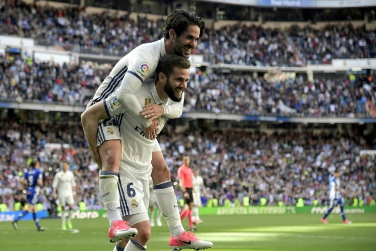 Real Madrid's defender Nacho Fernandez celebrates a goal with midfielder Isco during a Spanish league football match against Deportivo Alaves at the Santiago Bernabeu stadium in Madrid on April 2, 2017