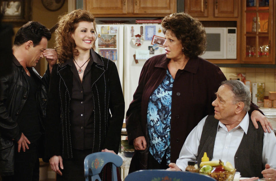 """FILE - Cast members, from left, Louis Mandylor, Nia Vardalos, Lainie Kazan and Michael Constantine, of the new CBS comedy series """"My Big Fat Greek Life,"""" based on the hit film """"My Big Fat Greek Wedding,"""" rehearse a scene on the set in Los Angeles on Feb. 14, 2003. Constantine, an Emmy Award-winning character actor who reached worldwide fame playing the Windex bottle-toting father of the bride in the 2002 film """"My Big Fat Greek Wedding,"""" died Aug. 31 in his home at Reading, Pennsylvania, of natural causes. He was 94. (AP Photo/Rene Macura, File)"""