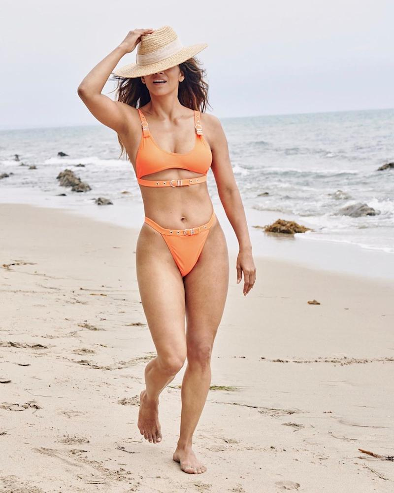 Halle Berry in an orange bikini and straw hat