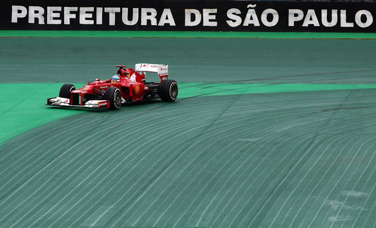 SAO PAULO, BRAZIL - NOVEMBER 25:  Fernando Alonso of Spain and Ferrari loses grip and runs wide at turn one during the Brazilian Formula One Grand Prix at the Autodromo Jose Carlos Pace on November 25, 2012 in Sao Paulo, Brazil.  (Photo by Paul Gilham/Getty Images)