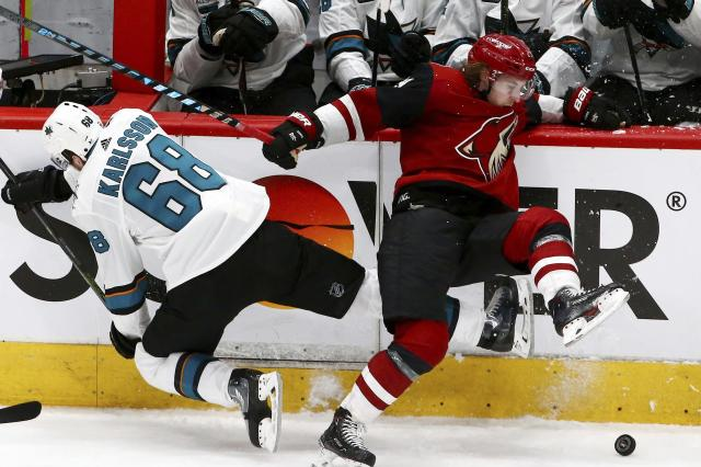 San Jose Sharks center Melker Karlsson (68) and Arizona Coyotes right wing Mario Kempe, right, collide along the boards during the third period of an NHL hockey game Wednesday, Jan. 16, 2019, in Glendale, Ariz. The Coyotes defeated the Sharks 6-3. (AP Photo/Ross D. Franklin)