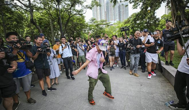 An elderly man dances during a protest against the damas in July, which about 2,000 people joined. Photo: Winson Wong