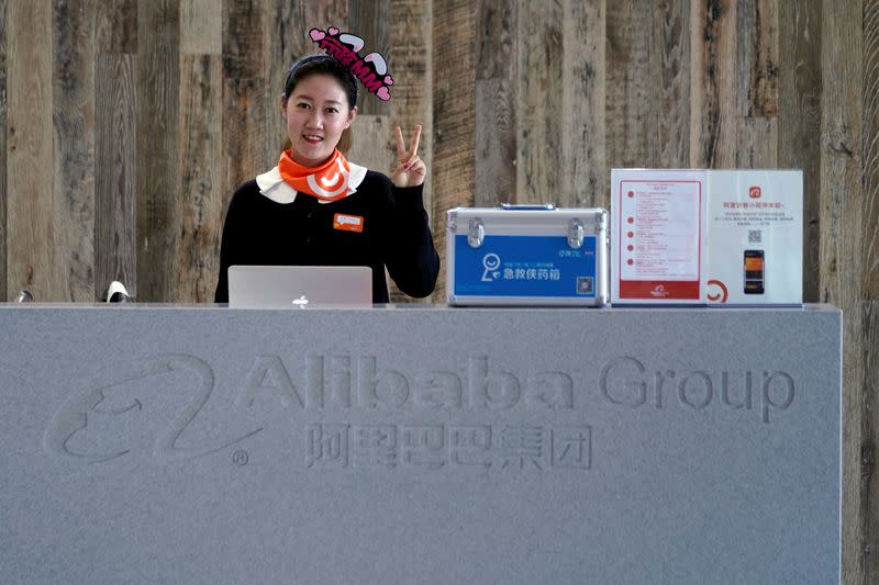 FILE PHOTO: An employee of Alibaba Group gestures during Alibaba Group's 11.11 Singles' Day global shopping festival at the company's headquarters in Hangzhou