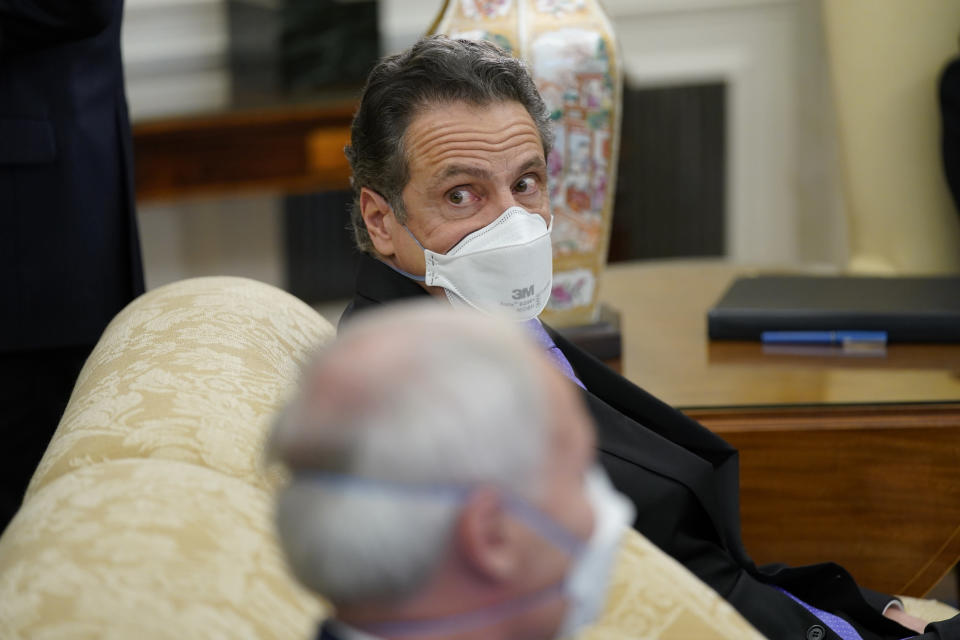 New York Gov. Andrew Cuomo attends a meeting with President Joe Biden and a bipartisan group of mayors and governors to discuss a coronavirus relief package, in the Oval Office of the White House, Friday, Feb. 12, 2021, in Washington. (AP Photo/Evan Vucci)
