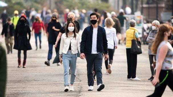 PHOTO: People wear face masks while walking in Central Park on March 11, 2021, in New York City. (Noam Galai/Getty Images)