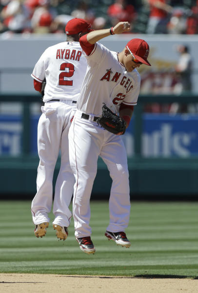 Los Angeles Angels shortstop Erick Aybar, left, and center fielder Mike Trout celebrates their 6-0 win against the Baltimore Orioles in a baseball game in Anaheim, Calif., Sunday, July 8, 2012. (AP Photo/Chris Carlson)