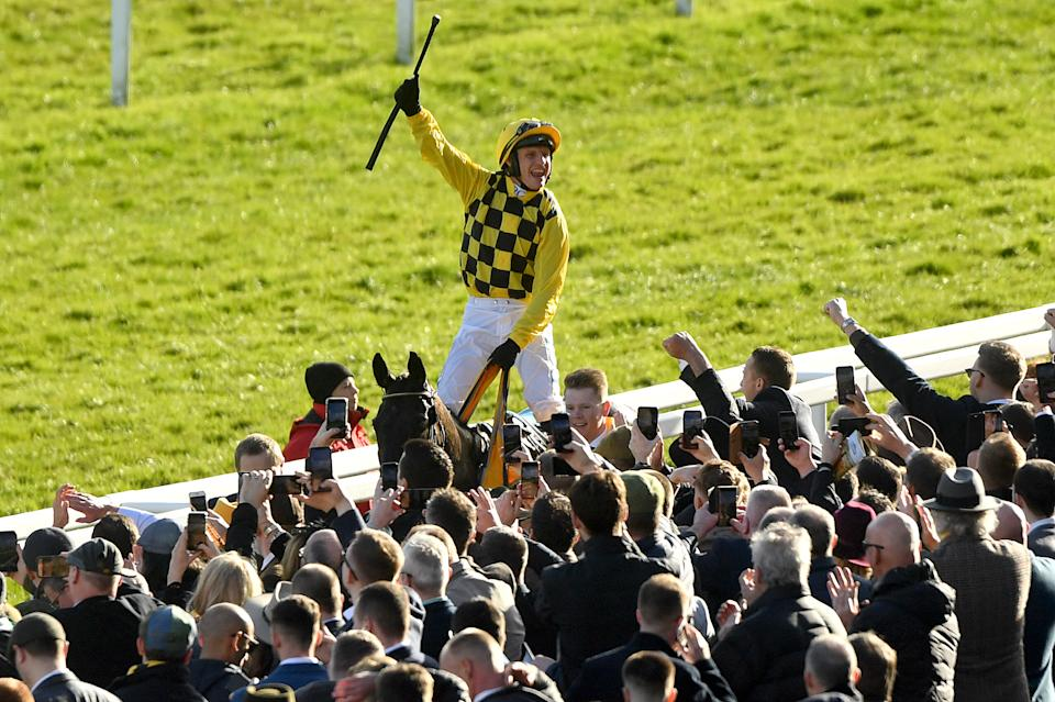 File photo dated 13-03-2020 of Jockey Paul Townend celebrates on Al Boum Photo after winning the Magners Cheltenham Gold Cup Chase.