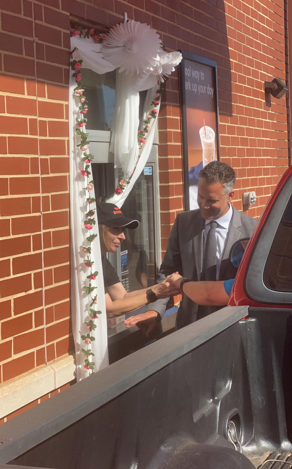 Sugar Good and John Thompson wed this month in the very place they first met: the Dunkin' drive-thru. (Courtesy Jillian Gallagher and Emma Burke)