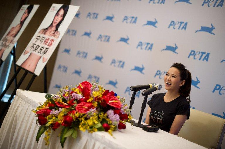 Taiwanese singer Annie Yi speaks to the media during a press conference in Beijing on March 8, 2012