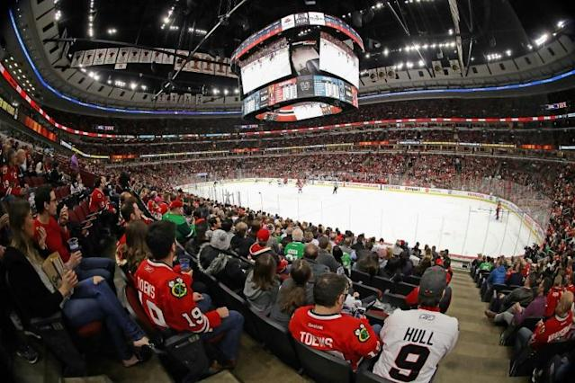 NHL fans watch the Chicago Blackhawks take on the San Jose Sharks a day before coronavirus halted the NHL season. Commissioner Gary Bettman remains confident play will resume (AFP Photo/JONATHAN DANIEL)