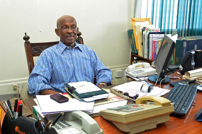 In this Friday, Feb. 22, 2013 photo, Georgetown Mayor Hamilton Green poses for a photo at his office in Georgetown, Guyana. In colonial times, the governor of what was then called British Guiana would impose hefty fines on officials of the capital for refusing to show up and do their job of running the city. Today, this rugged South American country has the opposite problem: The mayor and municipal councilors in the capital and five townships showed up for work nearly 20 years ago and essentially never left. (AP Photo/Adrian Narine)