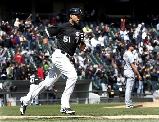 Chicago White Sox's Alex Rios heads to first after hitting a two-run home run off Cleveland Indians starting pitcher Zach McAllister, background right, during the fifth inning of a baseball game Wednesday, April 24, 2013, in Chicago. (AP Photo/Charles Rex Arbogast)