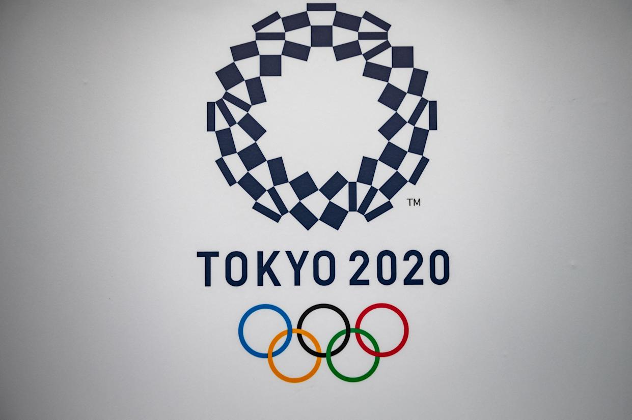 The Tokyo 2020 logo is seen at the Tokyo International Exhibition Centre, also known as Tokyo Big Sight, where the International Broadcast Centre and Main Press Centre for the Tokyo 2020 Olympic and Paralympic Games are located, in Tokyo on June 28, 2021. (Photo by Philip FONG / AFP) (Photo by PHILIP FONG/AFP via Getty Images)