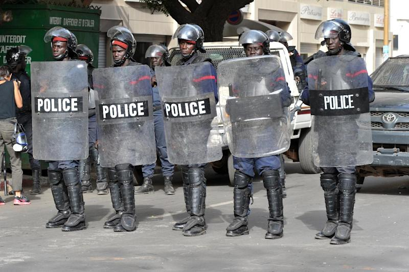Riot police stand guard in Independant Sqaure in Dakar on February 22, 2012