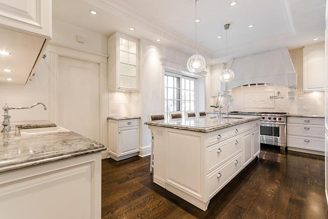"<p>The kitchen has granite countertops and stainless steel appliances, with a ""butler's pantry"" located close by. (Listing via <span>Sotheby's</span>) </p>"