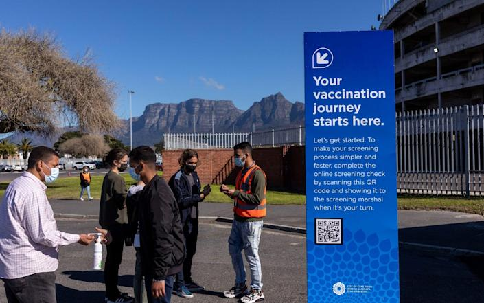 People arrive at a mass vaccination centre in Cape Town, South Africa on 20 August 2021 - Dwayne Senior/Bloomberg