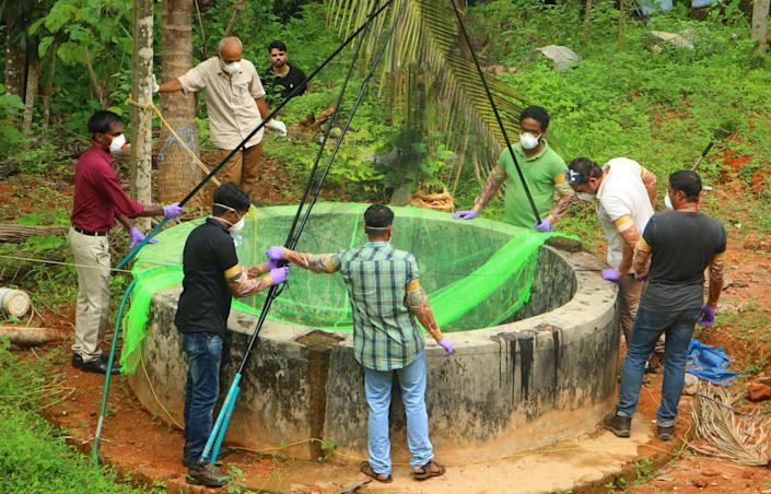 Animal Husbandry department and Forest officials inspect a well to to catch bats at Changaroth in Kozhikode in the Indian state of Kerala, May 21, 2018. / Credit: Getty