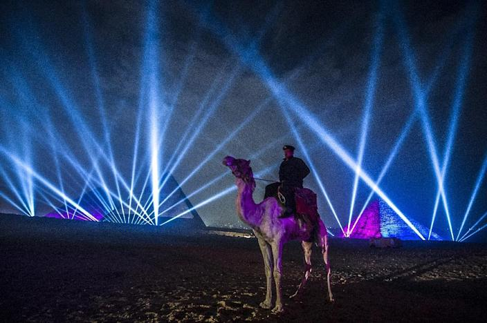 An Egyptian policeman riding a camel stands guard during celebrations in front of the pyramids on January 1, 2016 (AFP Photo/Khaled Desouki)