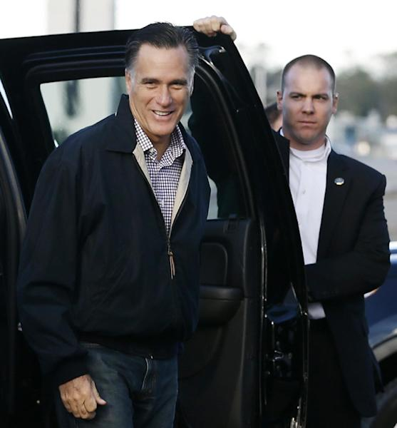 Republican presidential candidate, former Massachusetts Gov. Mitt Romney smiles as he gets out of his vehicle before he boarding his campaign plane in Bedford, Mass., Tuesday, Oct. 16, 2012. (AP Photo/Charles Dharapak)