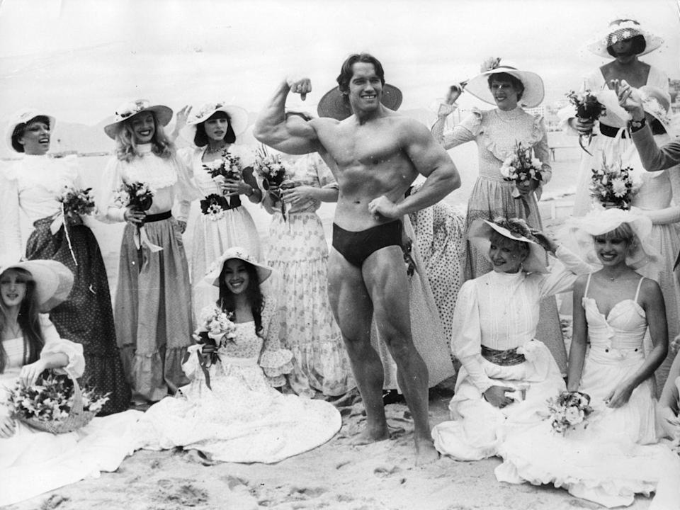<p>Arnold Schwarzenegger with the women from Folies Bergère at Cannes Film Festival in 1977. </p>