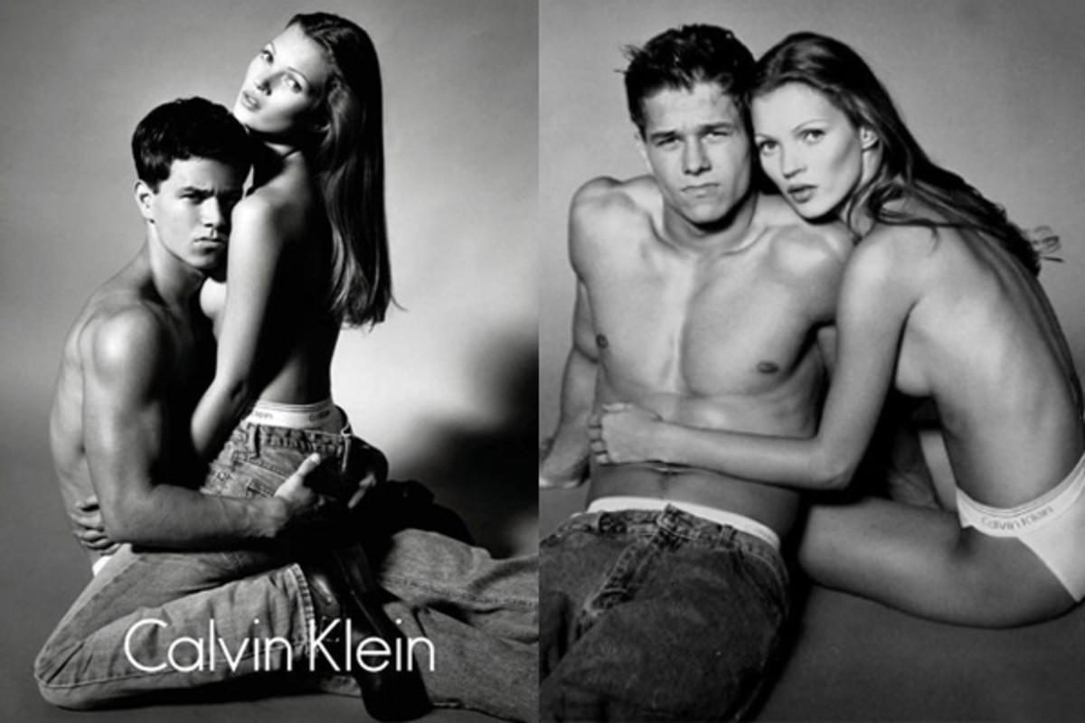 <p>Back before he became a respected actor and producer, Wahlberg snuggled up with a barely-clothed Moss. (Photo: Calvin Klein) </p>