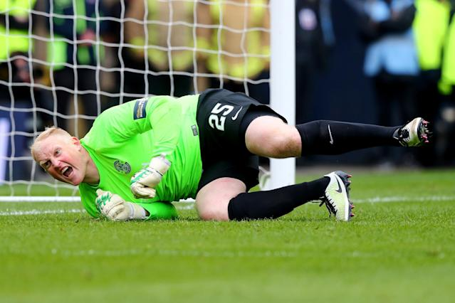 GLASGOW, SCOTLAND - APRIL 16: Conrad Logan of Hibernian celebrates after making his second save of the penalty shoot out during the Scottish Cup Semi Final between Hibernian and Dundee United at Hampden Park on April 16, 2016 in Glasgow, Scotland. (Photo by Clive Rose/Getty Images)