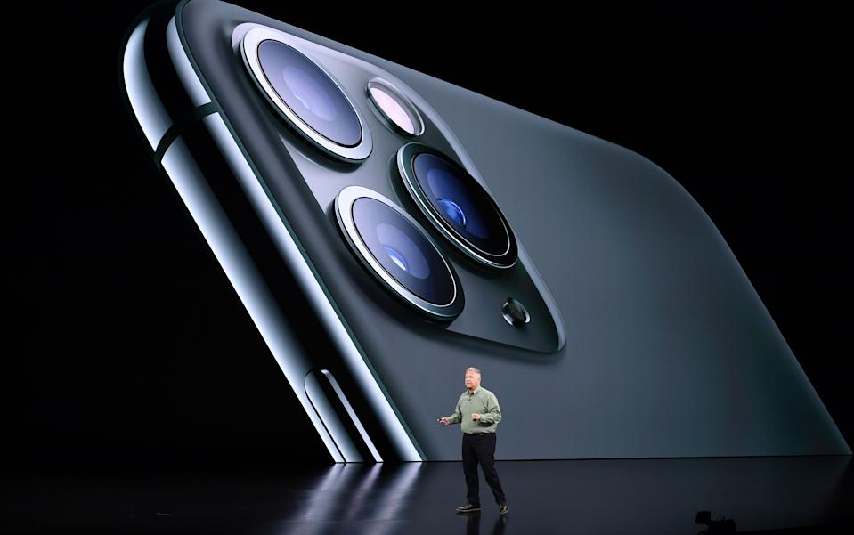 Apple Senior Vice President of Worldwide Marketing Phil Schiller speaks on-stage during a product launch event at Apple's headquarters in Cupertino, California, on September 10, 2019. - Apple unveiled its iPhone 11 models Tuesday, touting upgraded, ultra-wide cameras as it updated its popular smartphone lineup and cut its entry price to $699. (Photo by Josh Edelson / AFP)        (Photo credit should read JOSH EDELSON/AFP/Getty Images)
