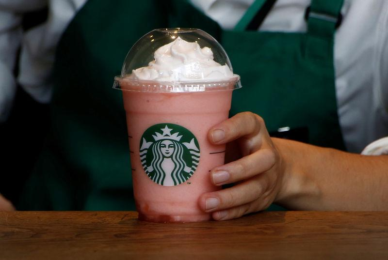 A waitress prepares a beverage at a branch of Starbucks coffee in Tokyo