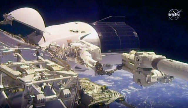Glover and Hopkins went spacewalking to install a high-speed data link outside the space station