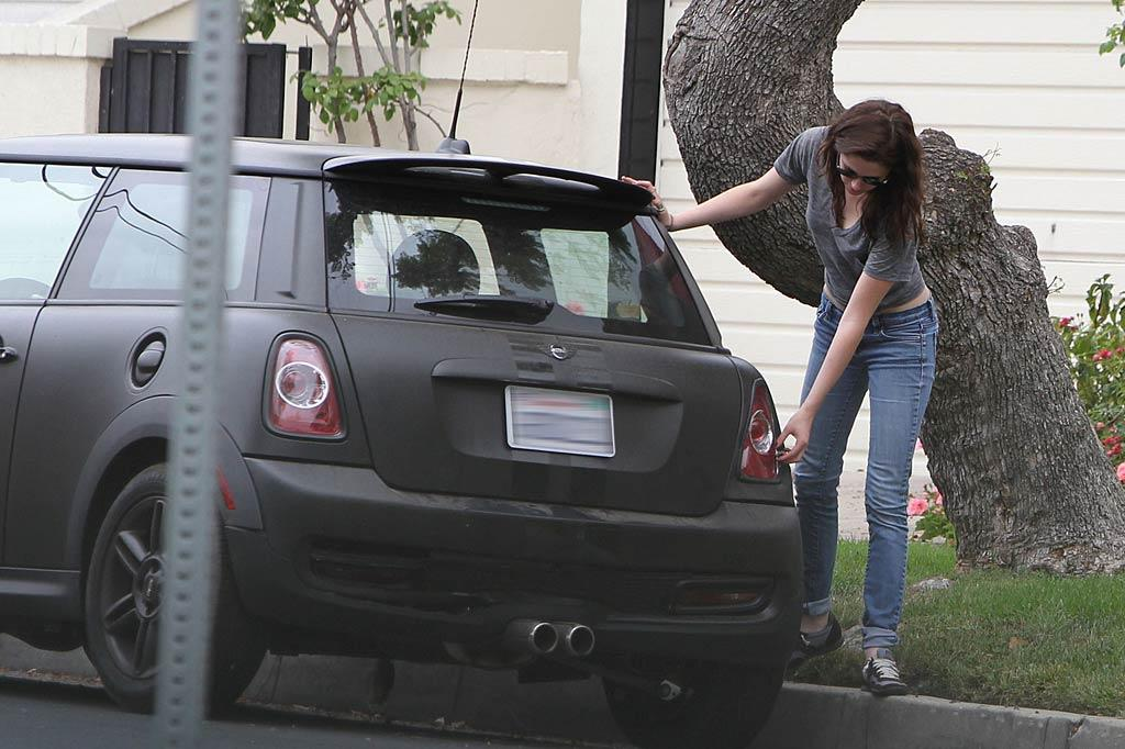"""Bummer! The casually-dressed KStew inspected her car for damage. Miguel Aguilar/Juan Sharma/<a href=""""http://www.pacificcoastnews.com/"""" target=""""new"""">PacificCoastNews.com</a> - July 14, 2011"""