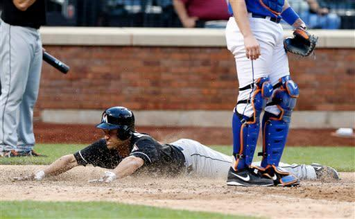 Miami Marlins' Placido Polanco (30) slides home to score the game-winning run on a single by teammate Adeiny Hechavarria in the 20th inning of a baseball game against the New York Mets at Citi Field in New York, Saturday, June 8, 2013. The Marlins won 2-1.(AP Photo/Paul J. Bereswill)