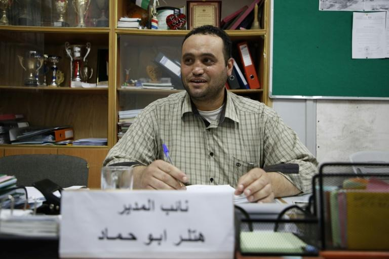Hitler Abu Hamad, deputy head at a school, sits at his desk in the Israeli occupied city of Hebron. Like many in the Palestinian territories, he carries a name that can make life difficult
