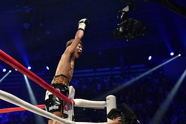 Japan's Naoya Inoue celebrates his win over Great Britain's Jamie McDonnell during their WBA world bantamweight title boxing bout in Tokyo (AFP Photo/Kazuhiro NOGI)