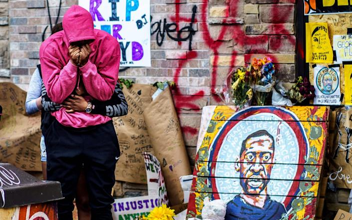 a makeshift memorial to George Floyd near the site where he died in police custody - Kerem Yucel/AFP
