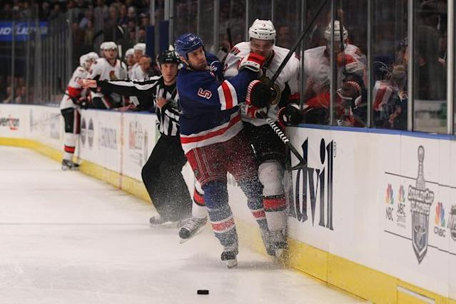 NEW YORK, NY - APRIL 26: Dan Girardi #5 of the New York Rangers checks Milan Michalek #9 of the Ottawa Senators in the third period of Game Seven of the Eastern Conference Quarterfinals during the 2012 NHL Stanley Cup Playoffs at Madison Square Garden on April 26, 2012 in New York City. (Photo by Bruce Bennett/Getty Images)