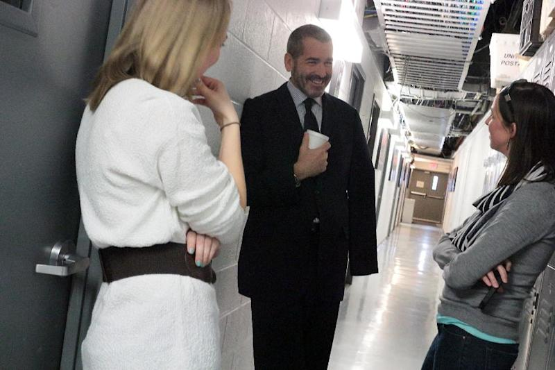 """This image released by PBS NewsHour shows science correspondent Miles O'Brien, center, speaking with reporter-producer Rebecca Jacobson, left, and senior online editor Jenny Marder at the WETA production center on Friday, March 7, 2014, in Arlington, Va. O'Brien, who lost part of his arm in an accident while on assignment last February, discussed his injury and amputation with Judy Woodruff on """"PBS NewsHour."""" (AP Photo/PBS Newshour, Joshua Barajas) MANDATORY CREDIT: Joshua Barajas"""